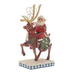 Dreams Delivered (Santa Riding Reindeer Figurine)